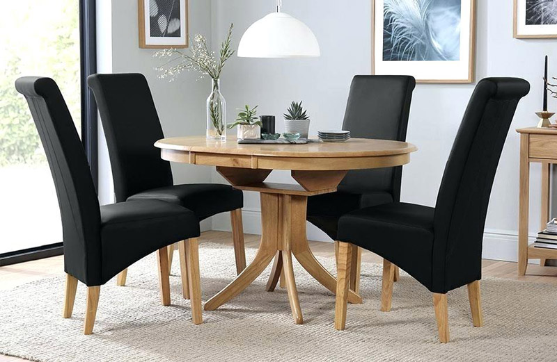 oak-table-with-black-chairs-round-extending-dining-4-6-and-friday.jpg