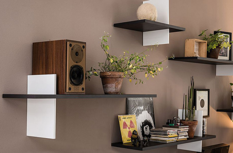 Built-in-book-ends-add-another-dimension-to-the-floating-bookshelves.jpg