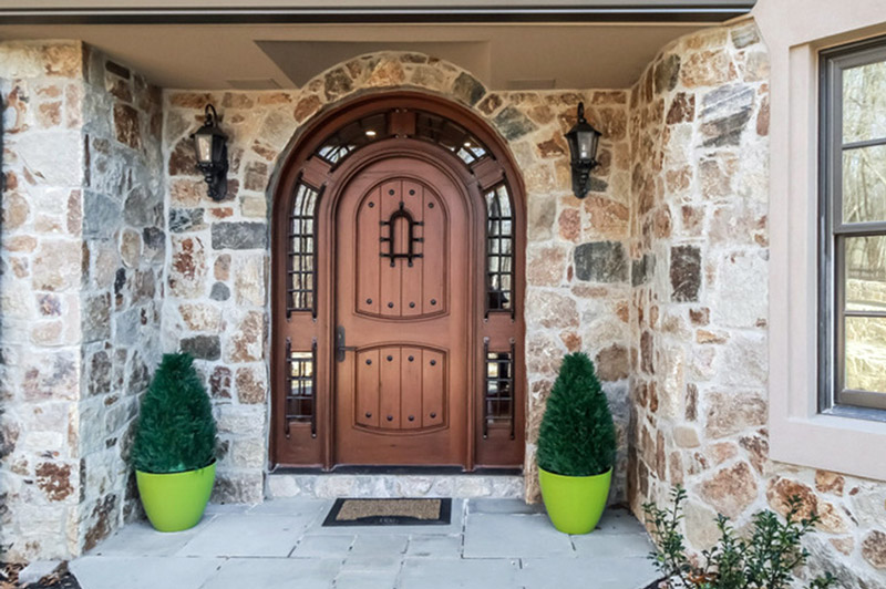 Teak_Arched_Top_Door_with_Surround_the_Pompano_in_Connecticut.jpg