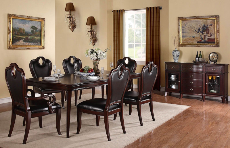 Glamorous-Formal-Dining-Room-Sets-with-Elegant-Chairs-in-Black-Color-Furnished-with-Elongated-Table-Decorated-with-Table-Decoration-and-Wall-Sconces.jpg